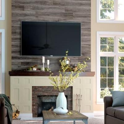 Laminate Flooring in Living room with entertainment area | HoC Flooring & Design